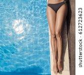 beautiful woman legs sunbathing ... | Shutterstock . vector #612723623
