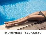 Beautiful Woman Legs Sunbathin...