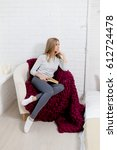 young woman relaxing on cozy... | Shutterstock . vector #612724478
