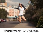 image of young happy woman ... | Shutterstock . vector #612730586