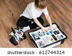 little schoolgirl is sitting on ... | Shutterstock . vector #612744314