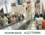 people in escalators at the mrt ... | Shutterstock . vector #612770984
