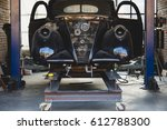 vintage garage with classic car ...   Shutterstock . vector #612788300