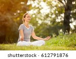 young female relaxes in yoga... | Shutterstock . vector #612791876