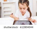 a cute little girl looking... | Shutterstock . vector #612804044