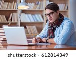 young book writer writing in... | Shutterstock . vector #612814349