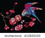 flowering branch with a bird on ... | Shutterstock .eps vector #612820103