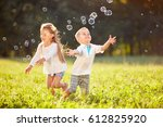 cheerful children run and chase ... | Shutterstock . vector #612825920