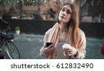 attractive woman standing in... | Shutterstock . vector #612832490