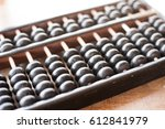 old abacus with natural light | Shutterstock . vector #612841979
