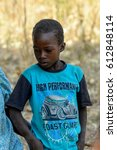 Small photo of KOUTAMMAKOU, TOGO - JAN 13, 2017: Unidentified Togolese little boy looks down in the village. Togo children suffer of poverty due to the bad economy.