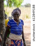Small photo of KOUTAMMAKOU, TOGO - JAN 13, 2017: Unidentified Togolese woman smiles in the village. Togo people suffer of poverty due to the bad economy.