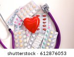 close up of pills spread over... | Shutterstock . vector #612876053