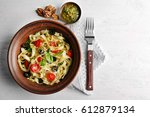 plate with delicious pasta on... | Shutterstock . vector #612879134