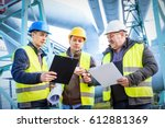 engineers discussing... | Shutterstock . vector #612881369