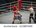 Small photo of St. Petersburg, Russia, November 23, 2016 Youth World Boxing Championship men, Boxing referee makes admonition to boxer