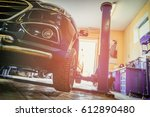 car in garage of auto repair... | Shutterstock . vector #612890480