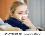 young woman with cold and... | Shutterstock . vector #612891530