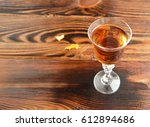 cognac is poured in a shot... | Shutterstock . vector #612894686