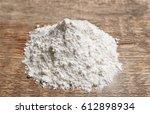 heap of flour on wooden table | Shutterstock . vector #612898934