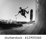 skateboarder doing kickflip on... | Shutterstock . vector #612905360