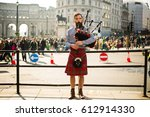 A Street Performer Playing His...