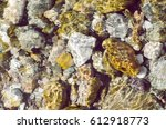 Closeup Of Blurred River Rocks...