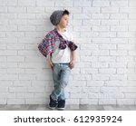 cute stylish boy near light... | Shutterstock . vector #612935924