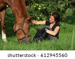 woman and horse resting at the... | Shutterstock . vector #612945560