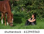 woman and horse resting at the... | Shutterstock . vector #612945563