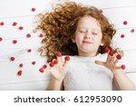 cute girl enjoying closing her...   Shutterstock . vector #612953090