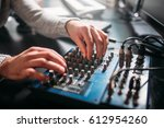 male sound engineer hands on... | Shutterstock . vector #612954260
