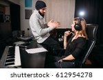 sound producer with female... | Shutterstock . vector #612954278