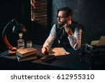 bearded writer in glasses... | Shutterstock . vector #612955310