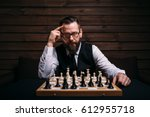 pensive chess player thinking... | Shutterstock . vector #612955718