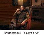 hunter man drink alcohol after... | Shutterstock . vector #612955724