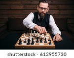 serious male chess player makes ... | Shutterstock . vector #612955730