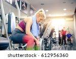 girl at gym having break ... | Shutterstock . vector #612956360