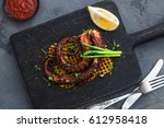 grilled octopus with vegetables ... | Shutterstock . vector #612958418