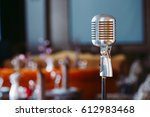 retro karaoke microphone on... | Shutterstock . vector #612983468
