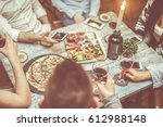 group of friends toasting red... | Shutterstock . vector #612988148