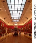 Small photo of London, England, UK - 14 July 2015: Art lovers gather in the long gallery at the Wallace Collection in London. Long skylight in the ceiling above illuminated gallery with natural light..