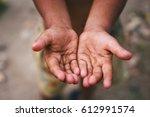 hands of a homeless child...   Shutterstock . vector #612991574