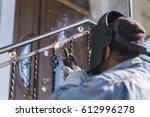 a worker welding metal... | Shutterstock . vector #612996278