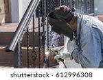 a worker welding metal... | Shutterstock . vector #612996308