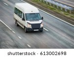 small white bus goes on highway ... | Shutterstock . vector #613002698