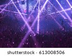 Stock photo light show and silhouette hands of audience crowd people use smart phones enjoying the club party 613008506