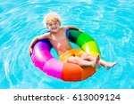 happy little boy playing with... | Shutterstock . vector #613009124
