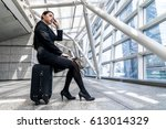 businesswoman sitting on carry... | Shutterstock . vector #613014329