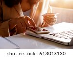 woman holding credit card and... | Shutterstock . vector #613018130